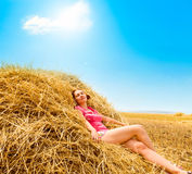 Rural girl in hay Royalty Free Stock Photos