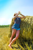 Rural girl in hay Royalty Free Stock Photos