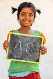 Rural Girl. Indian Rural Kid with slate Stock Photo