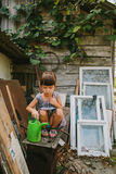Rural girl  among the old wooden trash Stock Photos
