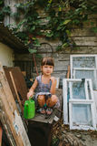 Rural girl  among the old wooden trash Stock Photo