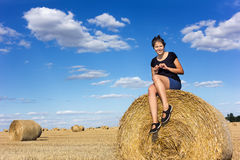 Rural girl on straw bale Royalty Free Stock Photos