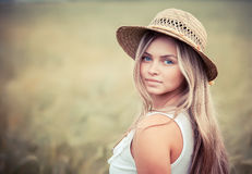 Rural girl in a straw hat Stock Photos