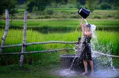 Rural girl is taking a shower from a traditional Groundwater at. Countryside Royalty Free Stock Images
