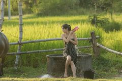 Rural girl is taking a shower from a traditional Groundwater at. Countryside Stock Images