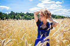 Rural girl wearing dirndl Royalty Free Stock Photos
