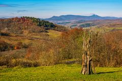 Rural grassy fields on hills in gorgeous mountains. Stunning countryside landscape in autumn Stock Photography