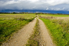 Rural gravel road in autumn Royalty Free Stock Images