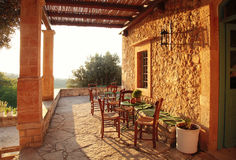 Rural greek country outdoor restaurant on pergola terrace with e Stock Photos