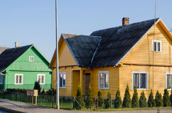 Rural green yellow painted houses along street Royalty Free Stock Images