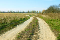 Rural ground road in autumn Stock Images