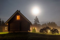 Rural guest house in the Moon light. Stock Photo