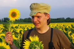 Rural guy in sunflower. Rural guy in Ukraine on field Royalty Free Stock Image