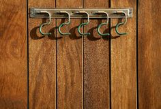 Rural hanger over wooden wall, horse stables. Rural steel hanger over tropical wooden wall, horse stables stock photo