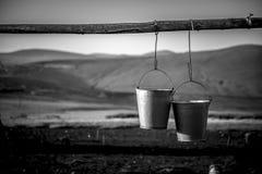 Rural Hanging metal buckets Stock Photography