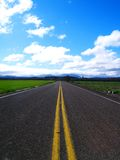 Rural Highway. A rural highway travelling through the farm fields Stock Photo