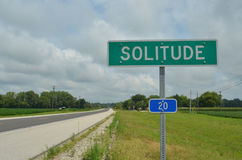Rural highway road sign SOLITUDE. Rural highway in America with road sign for SOLITUDE the name of a small town Royalty Free Stock Photos