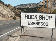 Rock Shop and Espresso. Rural highway sign, rock shop with espresso Royalty Free Stock Photography