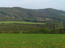 Rural hilly landscape, country with green meadow in summer, forest, Czech republic. Natural still life stock photography