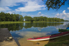 Rural holiday in Lithuania. Opportunity to relax and unwind. Boat and bungee jumping on the shore of the lake in the Lithuanian countryside Stock Photo