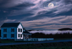 Rural home at night Stock Photo