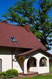 Rural home with oak tree in Poland Royalty Free Stock Photos
