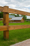 Rural home seen through fence Royalty Free Stock Images