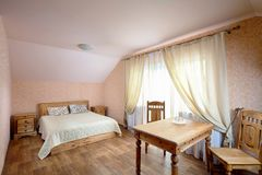 Rural Hostel Room. With Wooden Furniture in Dom in Koptevka stock photography