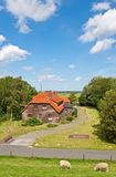 Rural House. This image shows a rural house at the north sea stock photo