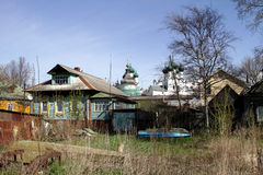 Rural house on a background of the Orthodox churches. Royalty Free Stock Image