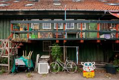 Rural house of Christiania Freetown with household items, garden accessories and bicycle royalty free stock images