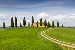 Rural house with cypress trees around, Tuscany, Italy Royalty Free Stock Photos