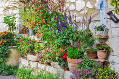Rural house decorated with flowers in pots, Gourdon Stock Images