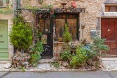 Rural house decorated with flowers in pots, Provence Stock Image