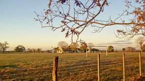 Rural House in the Field. Nice and peaceful view of a rural house in the filed with a soccer arc limited by a fence Stock Images