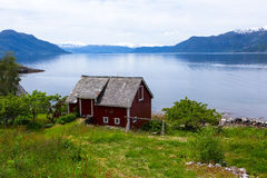 Rural house on a fjord coast Stock Image