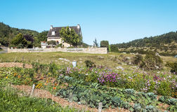 Rural house in France. Rural house in the mountain of France on a sunny day. You can see some flowers Stock Images