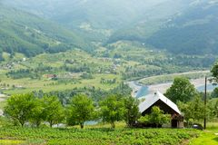 Rural house in mountains Stock Photos