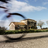 Rural house with moving bicycle Royalty Free Stock Images
