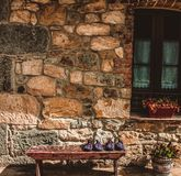 Rural house in the north of Spain with house slippers on the bench stock photo