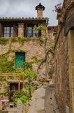 Rural house front northeastern Spain. Traditional fassade of a catalan rural house at the medieval town of Mura in northeastern Spain Royalty Free Stock Photo