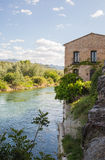 Rural house overhanging river Stock Image