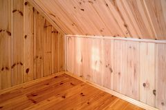 Rural house room corner interior as an example of carpentry from pine varnished boards and panels. Background stock images