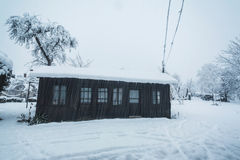 Rural house during snowfall Stock Photo