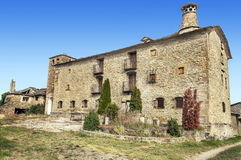 Rural house. Of stone with path situated in gesares village located in the spanish province of Huesca you can see  some trees and chimney in a sunny day Stock Images