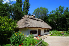 Rural house with straw roof Royalty Free Stock Photo