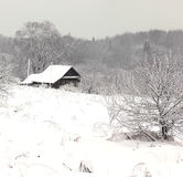 Rural house under the snow royalty free stock images