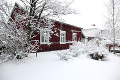 Rural house under snowfall Royalty Free Stock Photo