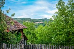 The rural house in the village. And view on hills Stock Image