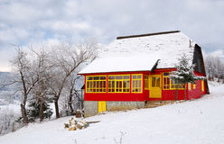 Rural house in winter landscape Stock Photos
